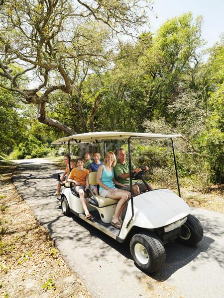 Family in golf cart. Stock photo © iofoto