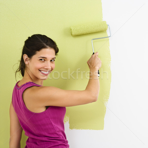 Stock photo: Happy woman painting.