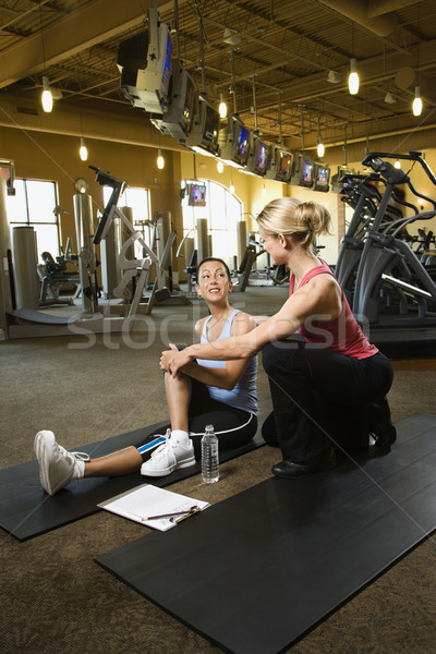 Woman with personal trainer. Stock photo © iofoto