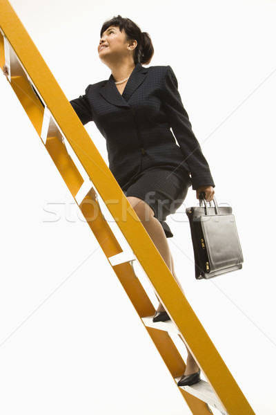 Businesswoman climbing ladder. Stock photo © iofoto