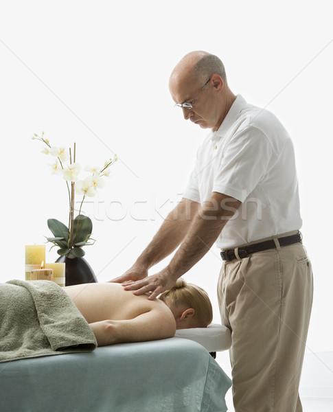 Man massaging woman. Stock photo © iofoto