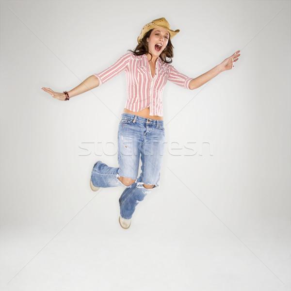 воздуха кавказский женщину ковбойской шляпе Сток-фото © iofoto