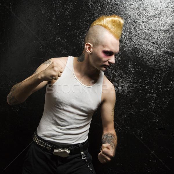 Punk mężczyzna patrząc człowiek mężczyzn Zdjęcia stock © iofoto