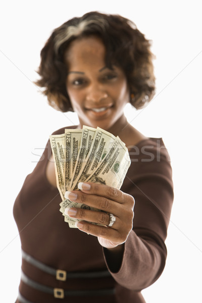 Woman holding money. Stock photo © iofoto