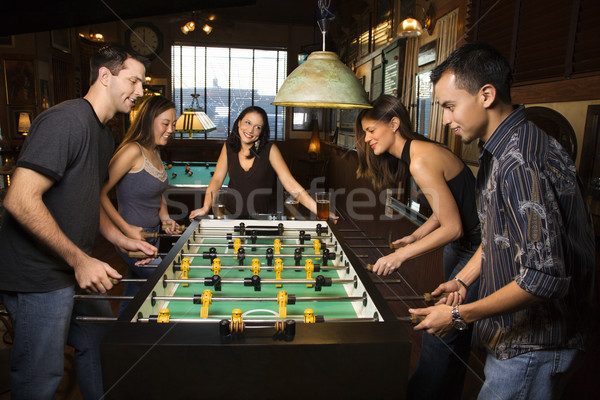 Group of People Playing Foosball Stock photo © iofoto