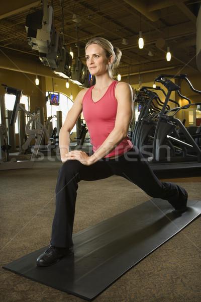 Woman stretching on mat. Stock photo © iofoto