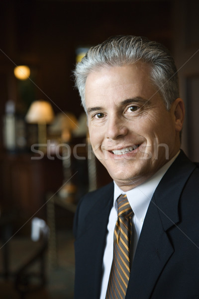 Businessman in hotel lobby. Stock photo © iofoto