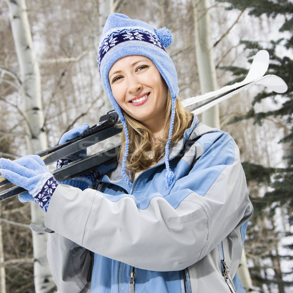 Female holding skis. Stock photo © iofoto