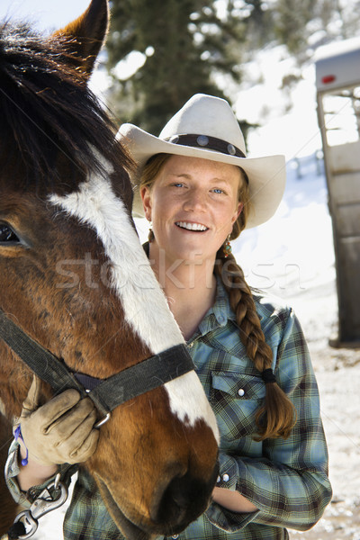 Attractive Young Woman Wearing Cowboy Hat Stock photo © iofoto