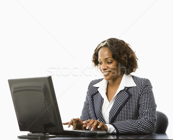 Businesswoman typing. Stock photo © iofoto