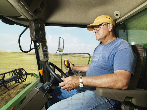 Farmer in combine. Stock photo © iofoto