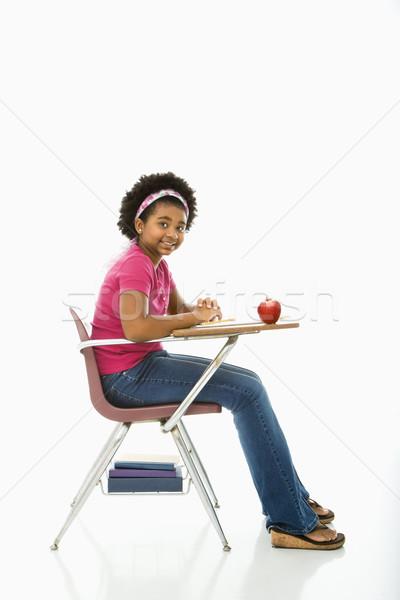 Lány iskola oldalnézet afroamerikai ül asztal Stock fotó © iofoto