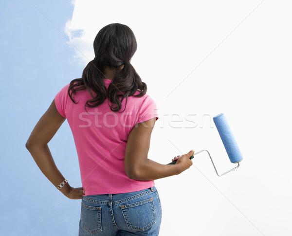 Woman observing paint job. Stock photo © iofoto