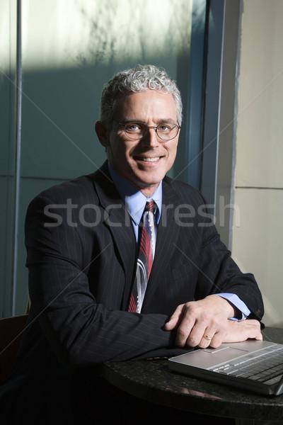 Businessman with laptop. Stock photo © iofoto