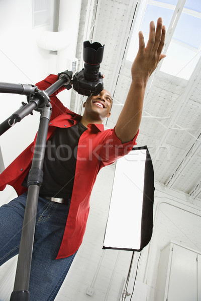 Photographer working in studio. Stock photo © iofoto
