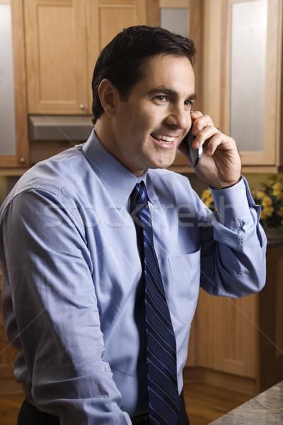 Businessman on cell phone. Stock photo © iofoto
