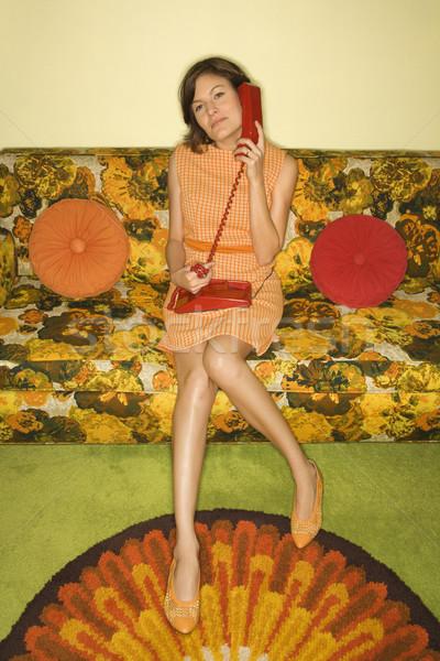 Woman sitting on sofa. Stock photo © iofoto