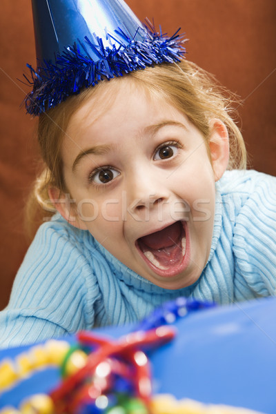 Excited girl at party. Stock photo © iofoto
