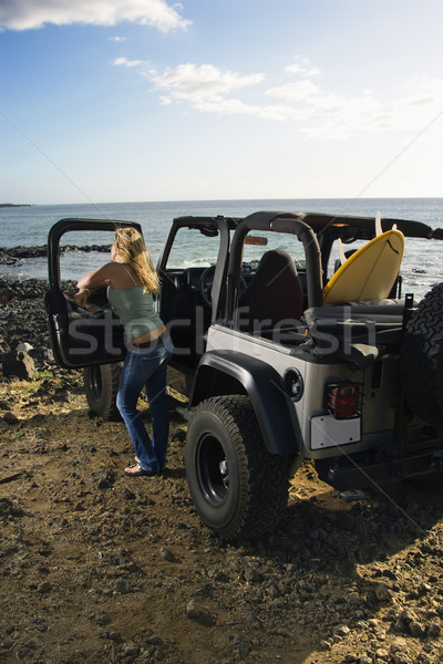 Woman with SUV at the Beach Stock photo © iofoto