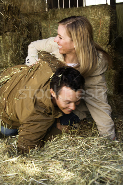 Couple playing in hay. Stock photo © iofoto