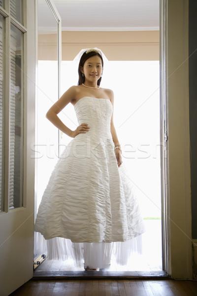 Bride standing in doorway. Stock photo © iofoto