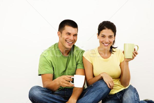 Mosolyog boldog pár ül padló iszik Stock fotó © iofoto