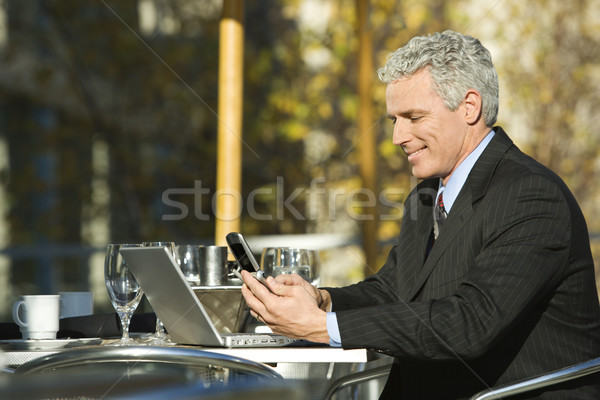 Businessman sitting outdoors. Stock photo © iofoto