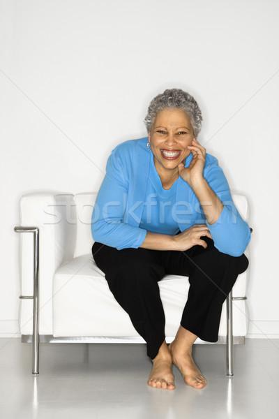 Woman sitting on chair. Stock photo © iofoto