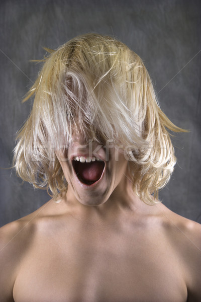 Teen boy screaming. Stock photo © iofoto