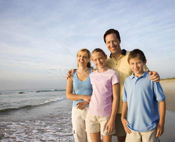 Smiling family on beach. Stock photo © iofoto