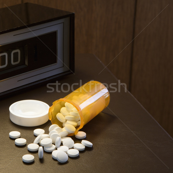 Pills spilling out of bottle. Stock photo © iofoto