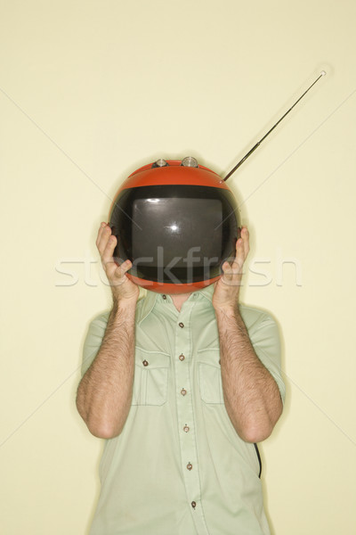 TV over man's head. Stock photo © iofoto