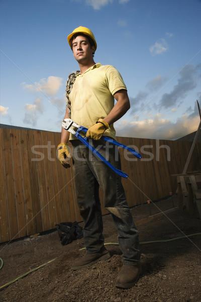 Komoly néz építőmunkás kosz tart csavar Stock fotó © iofoto