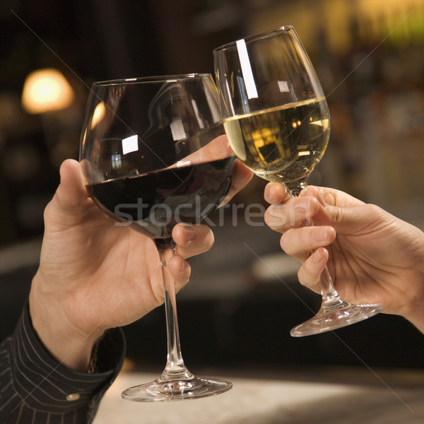 Hands toasting wine. Stock photo © iofoto