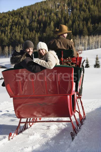 Couple on sleigh ride. Stock photo © iofoto