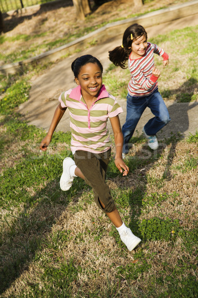 Young Girls Running on Grass Stock photo © iofoto