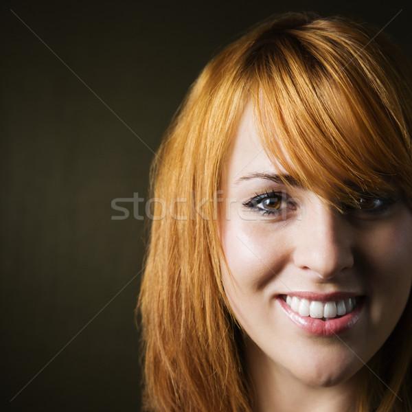 Uśmiechnięta kobieta studio portret dość młodych Zdjęcia stock © iofoto
