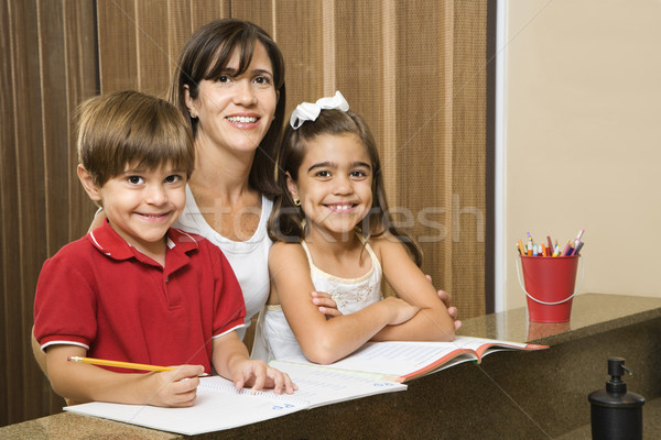 Mom and kids with homework. Stock photo © iofoto