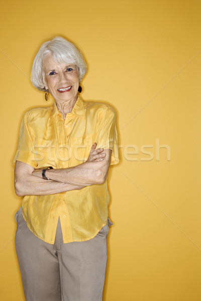 Woman standing smiling. Stock photo © iofoto