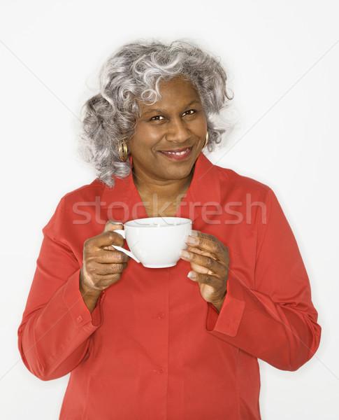 Woman holding coffee cup. Stock photo © iofoto