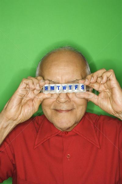 Homme pilule organisateur Photo stock © iofoto