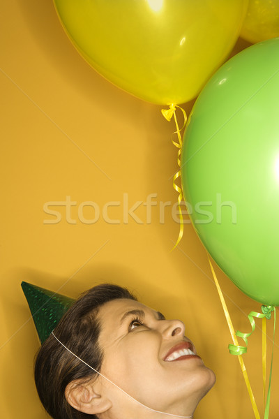 Woman in party hat with balloons. Stock photo © iofoto