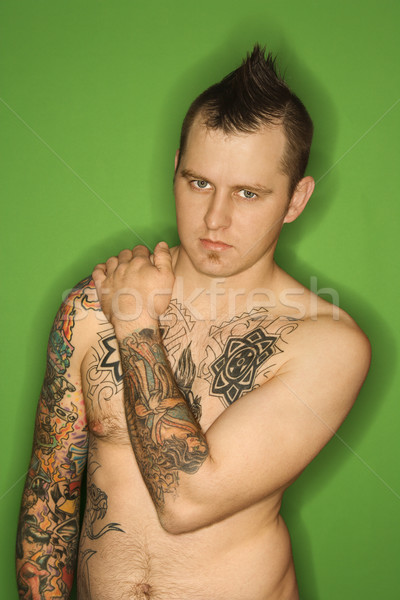 Shirtless man with tattoos. Stock photo © iofoto