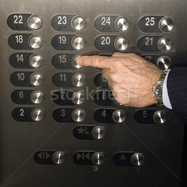 Hand Pushing Elevator Button Stock photo © iofoto