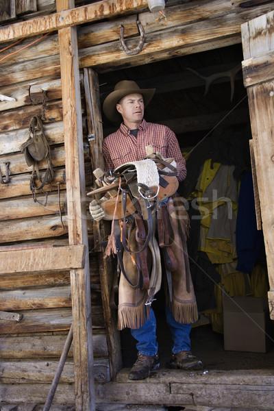 Adam kovboy şapkası eyer Stok fotoğraf © iofoto