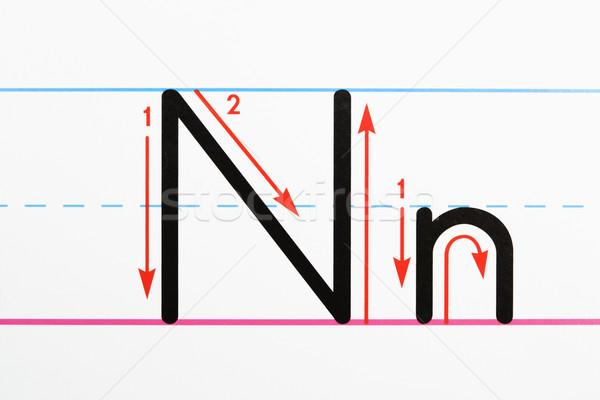 Kézírás gyakorlat közelkép n betű oldal papír Stock fotó © iofoto