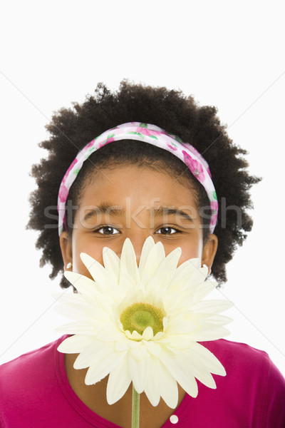 Girl with large flower. Stock photo © iofoto