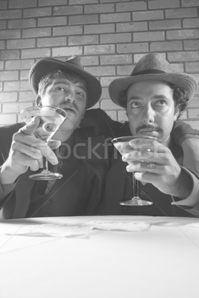 Retro businessmen with martinis. Stock photo © iofoto