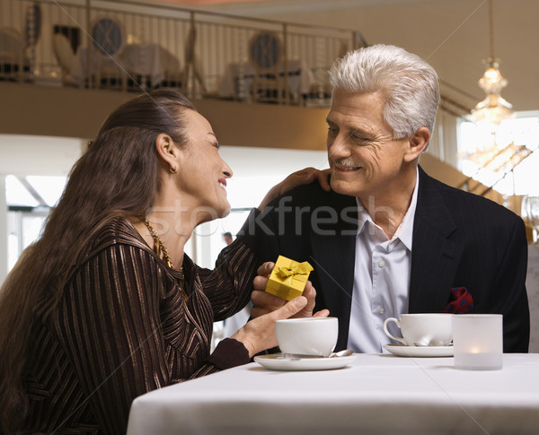 Man giving woman gift. Stock photo © iofoto