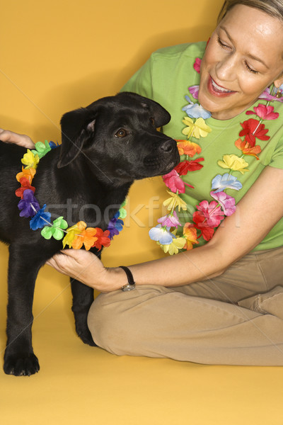 Woman with puppy wearing leis. Stock photo © iofoto
